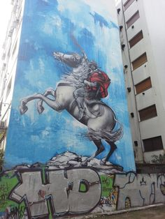 A mural featuring a gaucho figure on horseback by the British street artist Jim Vision