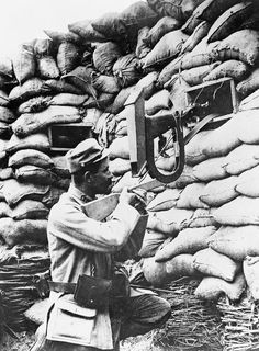 FRENCH ARMY WESTERN FRONT 1914-1918 (Q 69982)   French soldier using a periscope rifle in the sniping post.