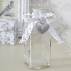 Clear Glass Bottle with Silver Heart
