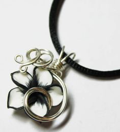 Perfume Pendant - PREMADE - Aromatherapy Wire Wrapped Black and White Polymer Clay Tropical Plumeria Flower by Nixcreations, $20.00