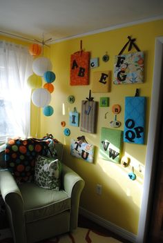 Great idea for art by the kids bed - safe, colorful, useful to put their art on.