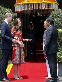 Britain's Prince William and his wife Catherine, Duchess of Cambridge, speak to the hotel staff after arriving at the Taj Mahal Palace hotel in Mumbai