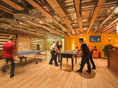 Employees in Moscow can play table tennis and foosball inside this cozy, wood-paneled room.