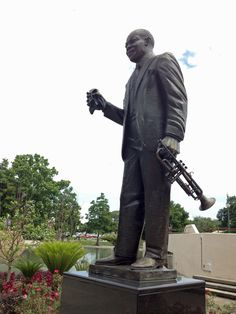 Louis Armstrong Park in the Tremé neighbourhood of New Orleans. The statue of Armstrong. Louisiana, Louis Armstrong Park, Second Line Parade, Birthday Weekend, Tour Guide, Monuments, Mardi Gras, New Orleans, Jazz