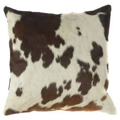 "Cowhide-inspired pillow with a down fill.  Product: PillowConstruction Material: Fabric cover and down-feather fillColor: Ecru, espresso, brown and blackFeatures: Cowhide-inspiredInsert includedDimensions: 18"" x 18""Cleaning and Care: Blot stains immediately. Dry clean cover."