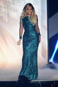 All eyes were on Beyonce as she took to the stage to perform at the 2014 BRIT Awards. Queen Bey channeled a mermaid with her glittering green dress and wavy hairstyle.