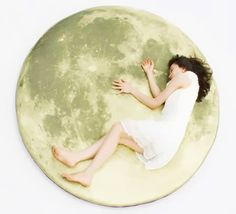 A pillow created with 26 hi-resolution images of the moon's surface, the Full Moon Odyssey floor pillow is one cool living room gadget that has a diameter of 5-foot wide. Designed by Lily Suh, a South Korean designer at i3 Labs.