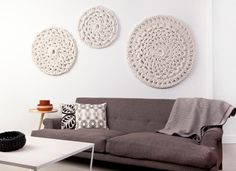 Crochet Motifs as wall art--yes yes!!  When someone finds out what kind of fiber is used and how much it costs please let me know.