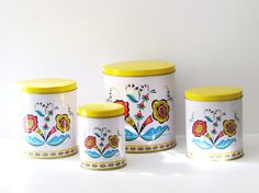 vintage tin canisters  set of four by OutAndAboutVintageII on Etsy
