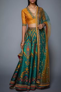 Featuring a green lehenga in silk dupion base with zardosi and tikki hand embroidery. It is paired with a matching mustard yellow blouse with dupatta. FIT: Fitted at bust and waist. CARE: Professional dry clean only. Lehenga Dupatta, Green Lehenga, Lehenga Choli Online, Indian Lehenga, Pakistani Bridal Wear, Pakistani Dresses, Indian Dresses, Indian Outfits, Indian Attire