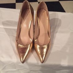 Aldo pumps Bronze/gold pointy pumps. I wore once to a wedding. They are a half size too big. ALDO Shoes Heels