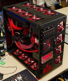 "Now that is a computer! •Intel Core i7 2700K •MB: EVGA Z68 •GPU: EVGA GeForce GTX 580 •RAM: 16 GB Mushkin •CASELABS Magnum TH10 •PS: Corsair ax1200 •SSD: (2) Corsair 120 GB Force GT, Raid 0 •HDD: Samsung 2TB Cooling: •Fan Ctrl: Sunbeam Rheosmart 6-channel •Fans: (29) Phobya Nano-2G 12 PWM Silent •Radiators: (1) Black Ice SR-1 480, (1)Black Ice SR-1 360 •Pump: D5, ½"" fittings •Water Block: Koolance CPU-370 •Tubing: Danger Den DreamFlex •Reservoir: FrozenQ Fusion dual bay"