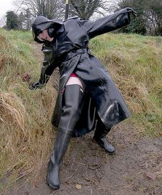 Waders and raincoat in the mud Heavy Rubber, Black Rubber, Parka, Black Raincoat, Pvc Raincoat, Hunter Wellies, Rubber Raincoats, Rain Gear, Raincoats For Women