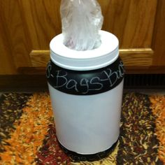 Plastic bag holder made from protein shake container and chalkboard paint :)