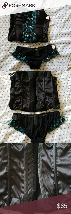 Black embroidered bustier camisole & mesh bikini Black satin bustier camisole & matching mesh bikini panties. Front panel has beautiful blue & green floral embroidery w/ sequin & tiny bow detailing. Lightly boned, adjustable hook & eye closure at back. Adjustable shoulder straps. Mesh bikini panties w/ matching embroidery on lace at hips. Intimates & Sleepwear