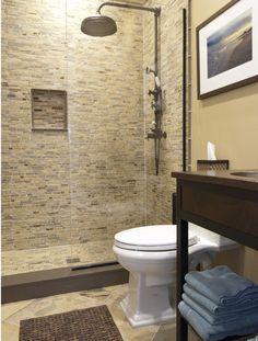 Art Exhibition Full shower in basement bathroom No tubs Frameless shower door keep it clean