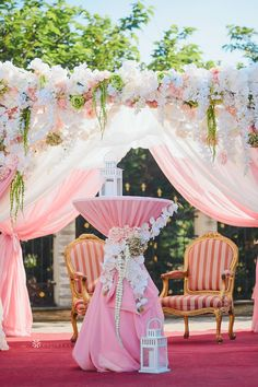 A wedding arch covered in blooming flower arrangements makes a romantic focal point for your spring wedding ceremony. Your guests will enjoy watching you exchange your vows as they gather under this charming arbor. Simple Wedding Arch with Flower Decorations for Outdoor Spring Ceremony. #weddingarch #weddingarchideas #weddingarchflowers #weddingarchesoutdoors #weddingarchideasdiy Outdoor Wedding Backdrops, Wedding Reception Backdrop, Wedding Aisle Decorations, Flower Decorations, Wedding Ceremony, Simple Wedding Arch, Wedding Arch Flowers, Wedding Ideas, Cocktail Table Decor