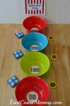 This site has a bunch of fantastic DIY carnival games and activities... including this bean bag toss made from $1 plastic bowls.