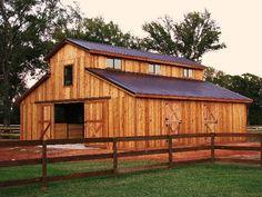 traditional raised center aisle barn style http://admin.barnsandbuildings.com/filemanager/files/gallery/Hemstead_TX/36x36_western_raised_Center_Barn.jpg