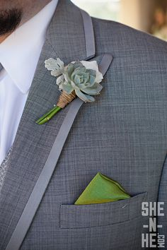 The boutonnieres will be blue succulent and gray dusty miller wrapped in raffia with the stems showing.  The groom's will have fresh lavender added to stand out.