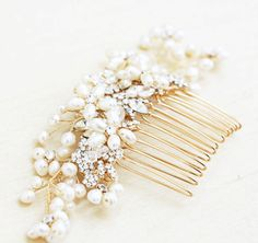 I made this beautiful, statement hair comb with freshwater pearls that I formed in the shape of flowers and gold rhinestones. It is attached