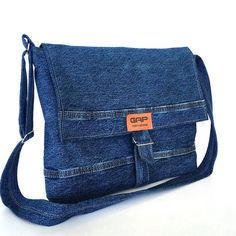 The fabric of this messenger bag was a denim pant before I give it a new life. It has one exterior pocket on the back side ,which is perfect for your cell phone or other small objects. A denim strap and 2 metal rings form closure of the bag. Adjustable strap, made from denim, offers custom-fit carrying. It is fully lined with a water repellent polyester fabric,and features 3 interior pockets. This comfortable and sturdy messenger bag is ideal for carrying your every day items to work or your…
