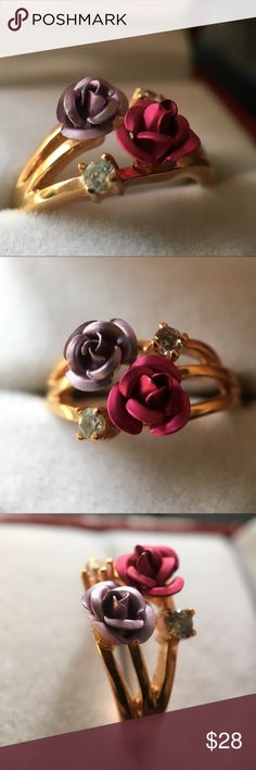 Rose ring, size 6 Beautiful gold ring with two metal roses on top and two stones:) Comes with a box, gently used:) I forgot the brand, we purchased it in a Bavarian tourist shop. Anthropologie Jewelry Rings