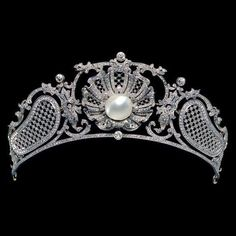 Edwardian-era platinum, diamond, and Mikimoto pearl tiara with a lattice motif flanking both sides of a delightful shell focal which can be detached and worn as a brooch (original fittings deficient).
