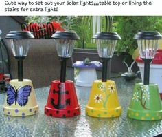 Solar lights in flower pots. Decorate the pots as you wish then place the solar lights in the bottom. Great for camping or a patio! - Gardening And Living Flower Pot Crafts, Clay Pot Crafts, Diy Crafts, Diy Flower, Clay Flower Pots, Flower Pot Art, Small Flower Pots, Flower Planters, Flower Ideas