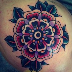 Traditional Flower Tattoo; flower mandala tattoo with dark, bold colors