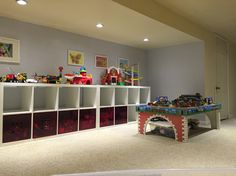 IKEA Kallax system with Lekman storage bins.  So much space for toys, Lego, trains and just stuff for the playroom.