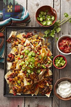 These five- nachos are a cinch to make for a large crowd. Bake a batch for your next party and serve with an array of topping options, like cilantro, jalapeno peppers, sour cream and salsa. Mexican Dishes, Mexican Food Recipes, Beef Recipes, Chicken Recipes, Cooking Recipes, Chicken Nachos Recipe, Skillet Recipes, Healthy Recipes, Cooking Tools