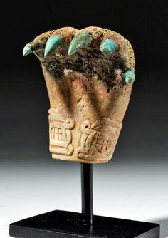 Pre-Columbian, North Coast Peru, Chavin, ca. 1400 to 400 BCE. A jaguar claw, hand-carved from a human elbow bone with striking pointy turquoise claws of brilliant aqua hues and a painstakingly carved, double-headed serpent design around the wrist