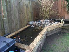 Wooden railway sleeper garden design fish pond