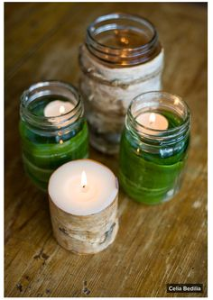 5. Dress up candles with woodsy details. Curl a wide green leaf and drop it into a glass jar — then fill the jar with water and float a tea light on top. Or use lengths of birch bark (available at craft stores) to wrap the outside of a jar or candleholder, and fasten them with twine. Found on houzz.com.