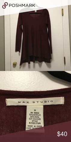 MAX Studio flowy sweater MAX Studio burgundy sweater. Nice fit through top and sleeves, with flowy bottom, just barely high-low design. Beautiful, high quality sweater. Max Studio Sweaters Crew & Scoop Necks
