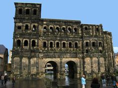 Trier, Germany. Porta Nigra, or the Black Gate, part of the defensive wall surrounding this ancient Roman settlement.  Also visit the gardens of the Dom (Cathedral) here in Trier.  Just outide of Trier a short distance are the remains of a Roman amphitheater.