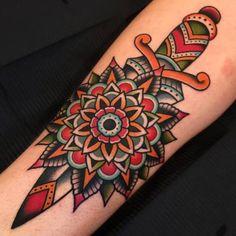 Post-Traditional Dagger with Mandala by Samuele Briganti at Bold Will Hold Tattoo Shop in Florence Italy Hawaiianisches Tattoo, Tattoo Shop, Leg Tattoos, Body Art Tattoos, Sleeve Tattoos, Trendy Tattoos, Tattoos For Women, Tattoos For Guys, Traditional Mandala Tattoo