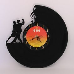 """Unique vinyl record clock made from a pre-loved 12"""" LP record. All my clocks are carefully and intricately carved by hand (no laser or CNC cutter"""