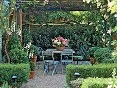 Scott and I are planning a pergola for the back yard. I would love mine to be draped with... bougainvillea, white wisteria, and climbing 'Sombreuil' and 'Iceberg' roses. A weathered dining table surrounded by mismatched chairs provides a peaceful spot for outdoor entertaining beneath the blooms. (Photo: Marion Brenner)