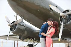 The airplanes, the '40s feel, the red lipstick + coiffed hair–very American, and oh-so romantic.  ©Mikki Platt
