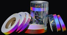 "HOLOGRAPHIC TAPES - These beautiful holographic adhesive tapes sparkle with a rainbow of colors.  They have a peel-off liner and can be used for exciting visual effects on dance & exercise hoops, gift packages, scrap books, etc.  Holographic tapes are 2.5 mils in thickness (0.0025"") and 1 inch in width."