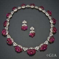 Art Deco carved ruby and diamond necklace and earrings by Mauboussin circa 1930. Image courtesy of a private collector.