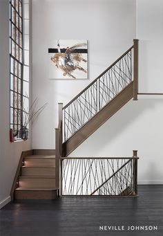 A true statement staircase, this contemporary steel design brings century style to the room. The unique balustrade design has been constructed out of strong steel spindles set into a solid wood base for a modern, eye-catching result. Balcony Railing Design, Home Stairs Design, Home Interior Design, House Design, Staircase Design Modern, Balustrade Design, Staircase Railings, Bannister, Staircases