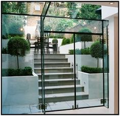 A modern glass box extention, bringing the outside in