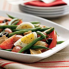 Make Woman's Day your source for healthy recipes, relationship advice and DIY home decor ideas. Tuna Nicoise Recipe, Tuna In Olive Oil, Pitted Olives, Plum Tomatoes, Salad Ingredients, French Food, Fruit Smoothies, Fish And Seafood, Bon Appetit