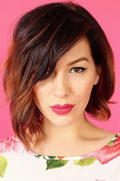 Reminds me of Lena Heady. Gorgeous hair paired with bright lip color. Hello!