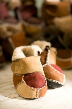 Patchwork Sheepskin Baby Booties, MULTI, Size 18 by Overland Sheepskin Co. $24.50. Soft shearling sheepskin cradles your baby's feet with cozy comfort. Slip on these handmade booties -- each pair with its own unique patchwork design -- and your little ones will be comfy for hours. Soft suede soles keep them slip-free when baby starts walking, and Velcro closures keep them on nice and snug. Equally cute with cuffs rolled up or down. Made in Canada.