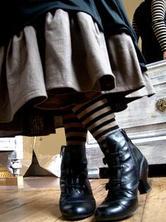 Black and khaki layers with black and khaki striped tights and granny boots. Adorable!