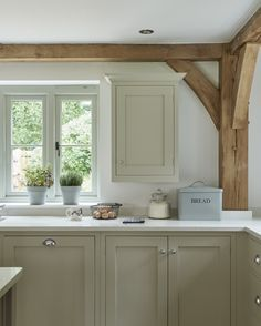 Beautiful shaker style kitchen in a soft cream with oak beams.
